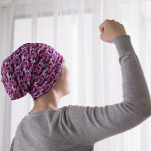 Cancer patient showing strength